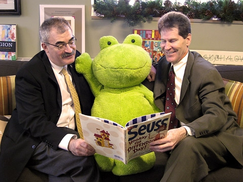 Larry Pogemiller and Steven Rosenstone reading book